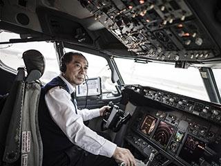【图片故事】功勋老机长的最后一班春运