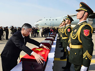 中韩举行第四批志愿军遗骸交接仪式