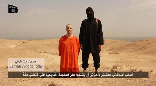 """詹姆斯/据悉,伊拉克极端组织""""伊斯兰国""""发布视频展示对美国被俘记者..."""